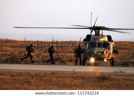 HATZERIM,ISRAEL - JUNE 28 2007: Special forces elite unit 669 is demonstrating its evacuation skills during combat using a UH-60 Black Hawk helicopter at the Hatzerim Air Force in Beer Sheva, Israel.