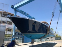 Haulout blue motor yacht for repair