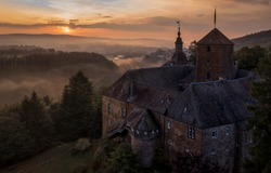 Haunted castle hill house at sunset. Sunset fog haunted hill house. Haunted castle on hill. Haunted hill house view