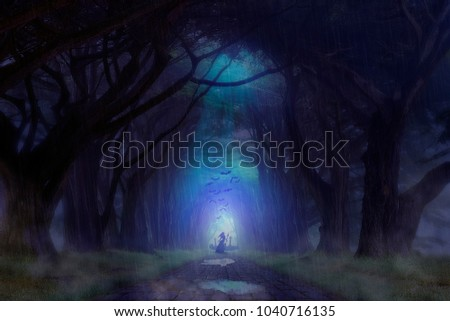 Haunted Forest Cemetery with Ghost standing in front of it with weapon in hand.