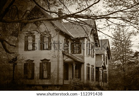 haunted house in sepia tones - stock photo