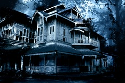 Haunted house. Old abandoned house in the night forest. Scary colonial cottage in mysterious forestland. Photo toned in blue color