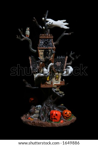 Haunted house tree over black