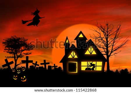 Haunted mansion with Jack O Lantern and spooky graveyard in front of it