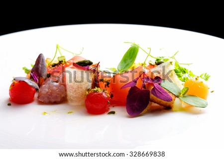 Haute cuisine appetizer with tuna tartare, watermelon and spices #328669838