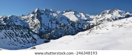 Haute Pyrenees panorama from Saint Lary Soulan via Neouvielle massif in winter, following the annex of Aure valley.  Slopes of the ski resort are at foreground