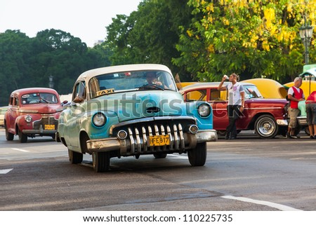 HAVANA-AUGUST 14:Shabby old american car August 14,2012 in Havana.These old cars,the only ones that could be bought until a recent law last year,are an iconic sight on the streets of the city