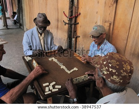 HAVANA - CIRCA FEBRUARY 2009:  Four unidentified elderly men play dominos, circa Feb. 2009, in Havana.