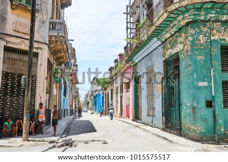 Havana, Cuba, AUG 5, 2017: A street view of old Havana, Capital of Cuba, with some children take shelter from the sun.