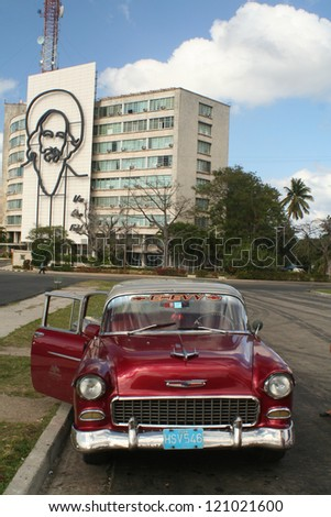 HAVANA, CUBA - CIRCA FEB. 2011: Old American car parked on Plaza de la Revolucion, known for Fidel Castro's speeches, sometime few hours long, circa February 2011 in Havana , Cuba