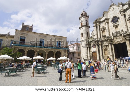 HAVANA, CUBA  - JANUARY 29: Square on January 29, 2007: street scene in the cathedral square, stands the Cathedral of San Cristobal. This is a typical place frequented by visiting tourists. - stock photo