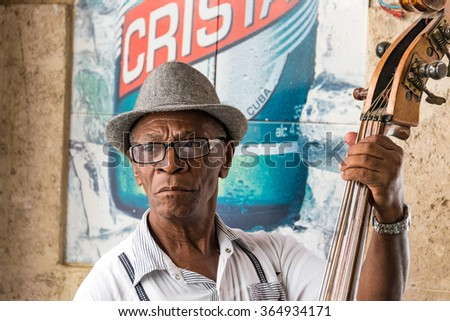 Shutterstock HAVANA,CUBA-JULY 4,2015: Traditional Cuban musicians playing son in a bar. Self employed musician entertain tourism in Old Havana and make good money after the economic changes of Raul Castro