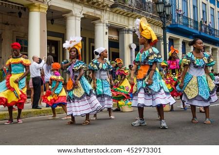 HAVANA, CUBA - JUNE 9, 2016: Dancers in colorful costumes celebrate Havana Day with a parade along Paseo de Marti in the historic La Habana Vieja neighborhood. #452973301