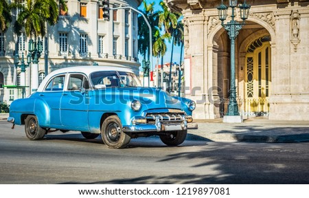 Havana, Cuba - June 27, 2017: HDR - American blue classic car with white roof drived on the main street in Havana City Cuba - Serie Cuba Reportage #1219897081