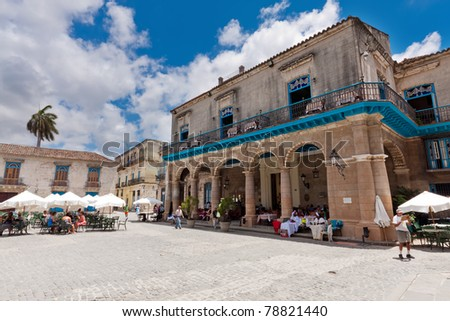 HAVANA, CUBA-JUNE 4: Tourists sit at a restaurant in the Cathedral Square June 4,2011 in Havana.Cuba attracts over 2 million people a year who come to the island fascinated by its distinct cultural history