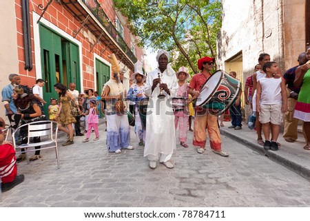 HAVANA, CUBA-JUNE 4: Unidentified musicians in Old Havana perform on June 4, 2011 in Havana, Cuba. Street artists perform in the colonial city help to create a colorful atmosphere which attracts more than 1 million tourists a year.