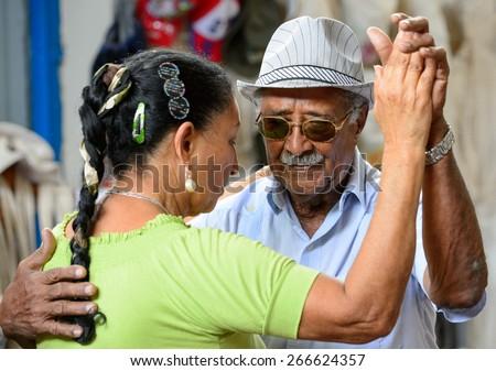 Havana, CUBA - March 20, 2015: An older couple dancing Salsa in the streets of Havana, Cuba