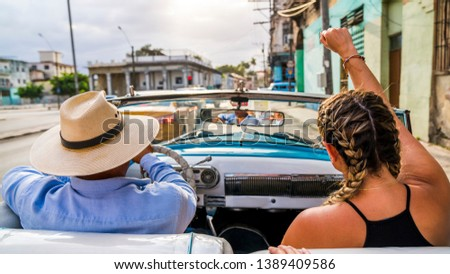 Havana Cuba. View from inside an old vintage classic American car. Close up of the driver and passenger.