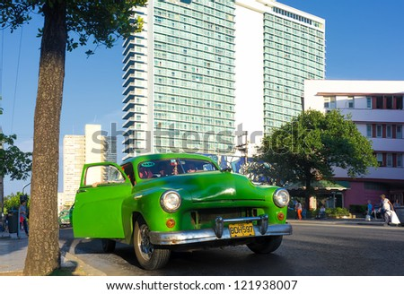HAVANA-DECEMBER 12:Vintage american car at the neighborhood of El Vedado December 12,2012 in Havana.Thousands of old cars are in use in Cuba and they have become an iconic view of the cuban cities