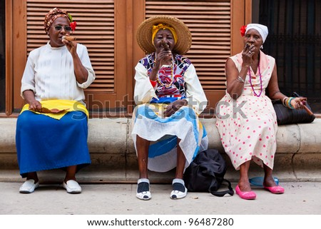 HAVANA-FEBRUARY 26:Women in typical clothing February 26,2012 in Havana.With the growth of foreign tourism people like these,working for tips,make their living posing as traditional cuban characters - stock photo