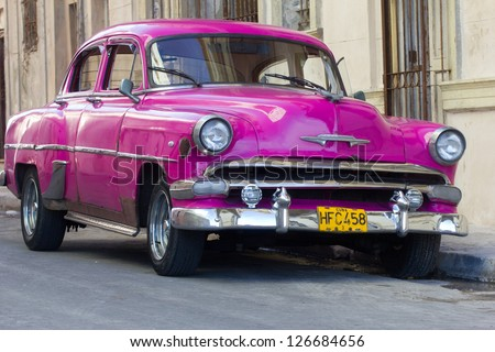 HAVANA - JANUARY 14: A classic Chevrolet car in a street on January 14, 2013 in Havana. These old and classic cars are an iconic sight of the island