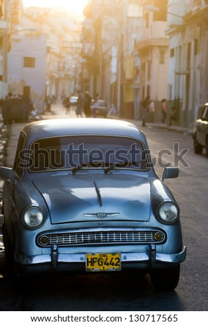 HAVANA - JANUARY 11: A vintage Chevrolet car in a street on January 11, 2013 in Havana. These antique cars are an iconic sight of the island