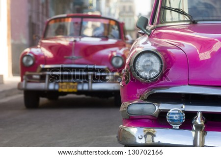HAVANA - JANUARY 14: Classic Chevrolet cars in a street on January 14, 2013 in Havana. These old and classic cars are an iconic sight of the island