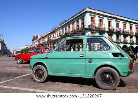 HAVANA - JANUARY 30: People walk past old Fiat 126 car on January 30, 2011 in Havana. Recent change in law allows the Cubans to trade cars again. Most cars in Cuba are very old because of the old law.