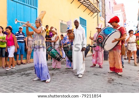 HAVANA-JUNE 4:Musicians in Old Havana June 4,2011 in Havana.Artists performing in the colonial city help to give this area the colorful atmosphere which attracts over 1 million tourists a year