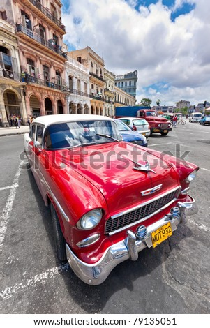 HAVANA-JUNE 4:Old Chevrolet in front of colorful buildings June 4,2011 in Havana.Cubans keep thousands of classic cars running despite the lack of parts and they've become an icon of the country