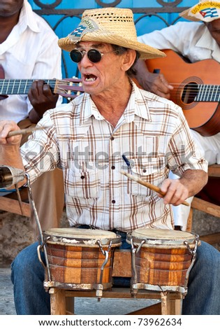 HAVANA-MARCH 25:Musician playing traditional drums March 25, 2011 in Havana.With the expansion of tourism,many cubans earn their lives working for tourists as street performers playing typical music