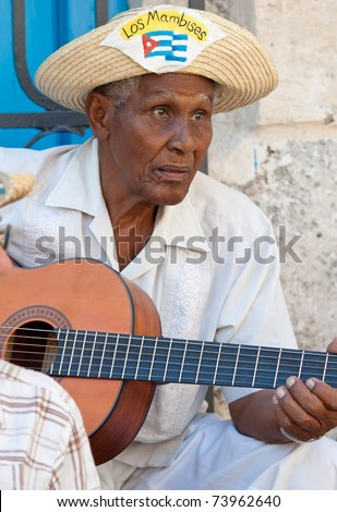 HAVANA-MARCH 25:Musician wearing typical clothes March 25, 2011 in Havana.With the expansion of tourism,many cubans earn their lives working for tourists as street performers playing traditional music