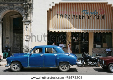 HAVANA - 27 MARCH: Vintage car in Cuba, Havana, March 27, 2007. October 2011, Cuban people finally got the right to trade on buying and selling cars. Ban on trade with cars was introduced in 1959. - stock photo