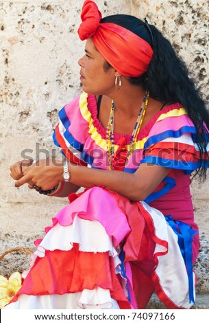 HAVANA-MARCH 25:Young Woman with typical clothes and accessories March 25, 2011 in Havana.People dressed in a way that represents the cuban nationality can still be found in the streets of Old Havana