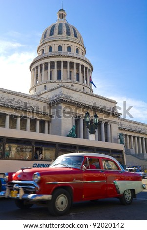 HAVANA, SEP 7: A vintage car circulating in front of the Capitol on September 7, 2011 in Havana, Cuba. Cubans, unable to buy newer models, keep thousands of them running.