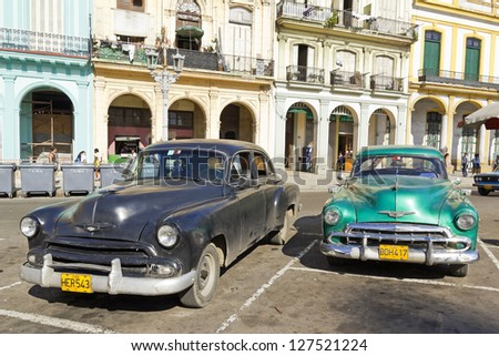 HAVANA-SEP 7: Old Plymouths parked front of the Capitol on Sep 7, 2011 in Havana. Before a new law issued on October 2011, cubans could only trade vintage cars that were on the road before 1959.
