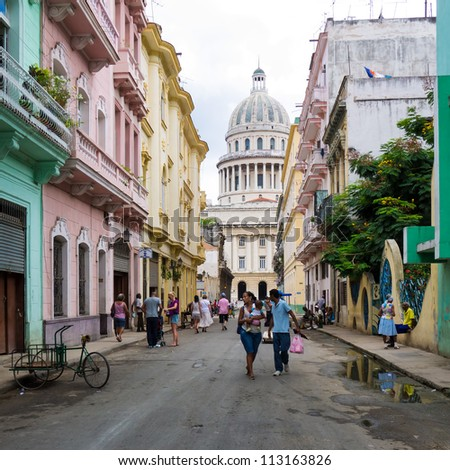 HAVANA-SEPTEMBER 13:Cuban people in a street leading to the Capitol September 13,2012 in Havana.With 2.4 million inhabitants and 3.7 in its urban area,Havana is the largest city in the Caribbean