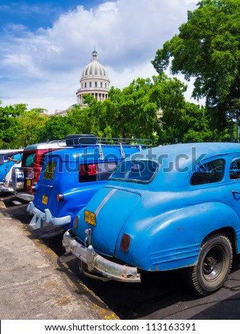 HAVANA-SEPTEMBER 13:Old cars near the Capitol September 13,2012 in Havana.Thousands of these cars are still used in Cuba by private taxi drivers who need to manufacture parts to keep them running