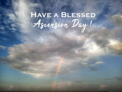 Have a blessed Ascension Day. Text greeting on blurry background of cloud human or angle shape and blue sky with the light of the rainbow.