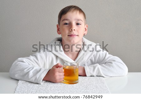 Have a nice tea! Boy with a cup of tea