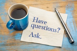 Have questions? Ask. Handwriting on a napkin with a cup of espresso coffee
