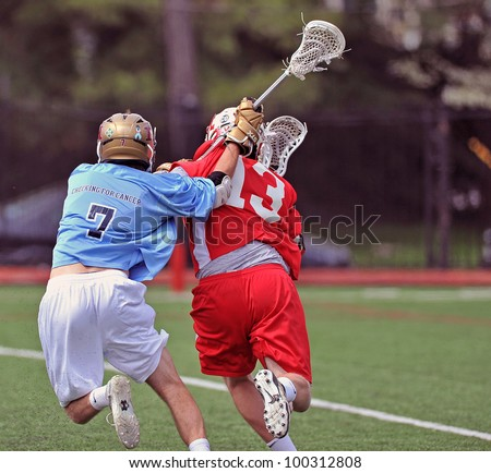 HAVERFORD, PA - APRIL 14: A player for the Haverford (PA) HS lacrosse team (#7) plays defense behind the net in the Checking for Cancer Invitational on April 14, 2012 in Haverford, PA.
