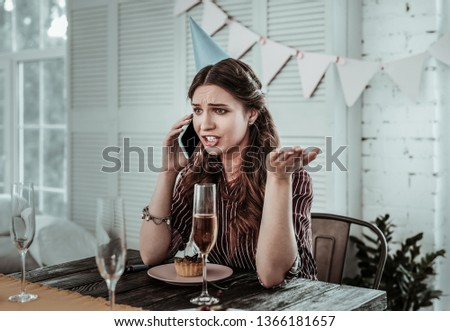 Having a phone conversation. A woman drinking champagne and talking on the phone #1366181657