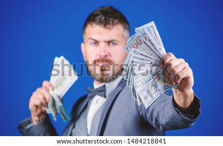 Having a rewarding job. Making money with his own business. Bearded man holding cash money. Currency broker with bundle of money. Rich businessman with us dollars banknotes. Business startup loan. #1484218841
