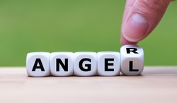 Having anger or being an angel? Hand turns a dice and changes the word
