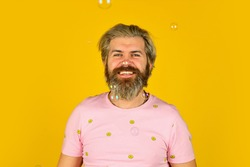 having fun. Fall into childhood. feeling childish and childlike. real happiness. mature man blowing soap bubbles. stay carefree at any age. man with bubble blower. happy hipster in playful mood.