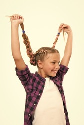 Having fun. Hairstyle diy. Girl long braids. Fashion trend. Fashionable cutie. Female hairstyle. Adorable child nice hairstyle. Happy childhood. Small girl with long braided hair. Hairdresser salon.