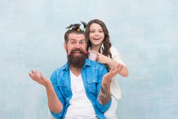Having fun. happy family day. small girl play with dad. bearded man father having fun with kid. childrens day. love and trust. daughter and father with funny hairdo. hairdresser and barbershop.