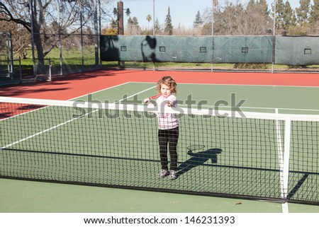 Having fun on a tennis court on sunny day.