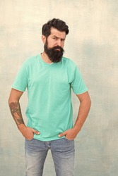 Having nice beard is distinguishable style that exuberant professionalism and manhood. Taking care of facial hair. Hair care. Find best beard design shape for facial hair. Bearded hipster brutal guy.